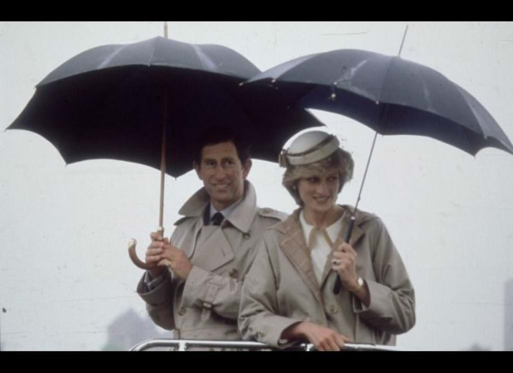 Charles and Diana wearing Burberry raincoats