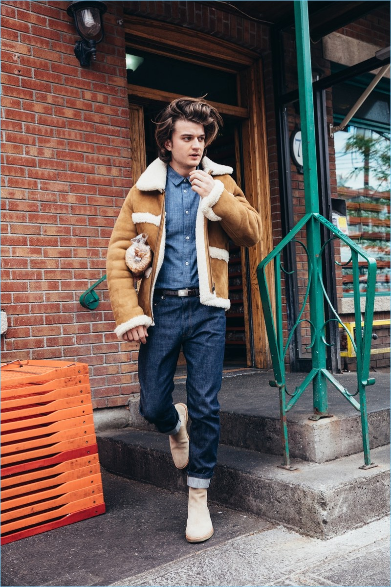 Stepping out, Joe Keery wears an A.P.C. x Louis W. shearling jacket. The Stranger Things actor also dons an A.P.C. denim shirt and jeans. New Republic by Mark McNairy boots and a J.Crew belt complete his look.