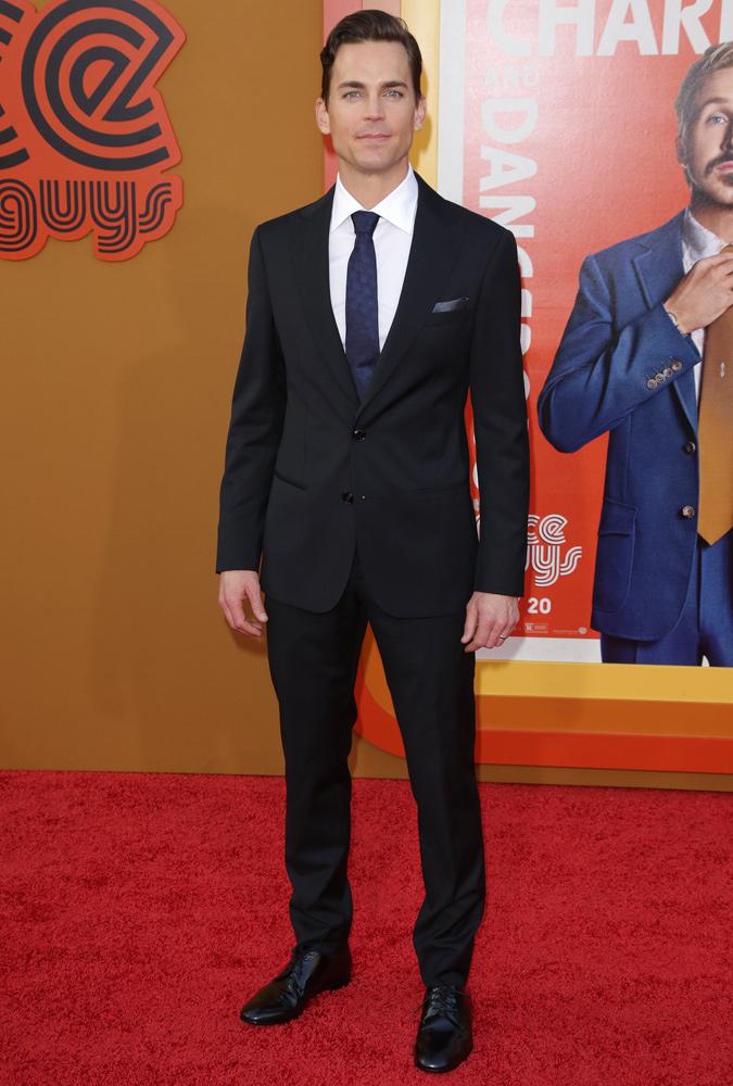 Matt Bomer Wearing A Navy Suit And Tie