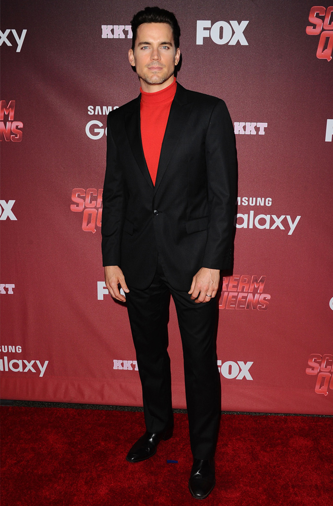 Matt Bomer Wearing A Suit And Red Roll Neck