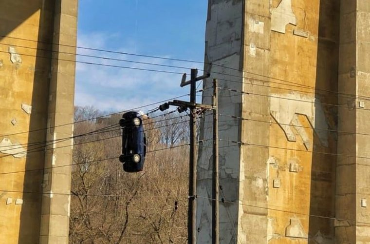 Prop or prank? Mystery car hanging from bridge perplexes Toronto residents