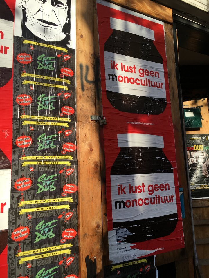 """Posters in Amsterdam saying """"I don't want monoculture."""" Protestors have criticized the """"commmercialization"""" of the city"""