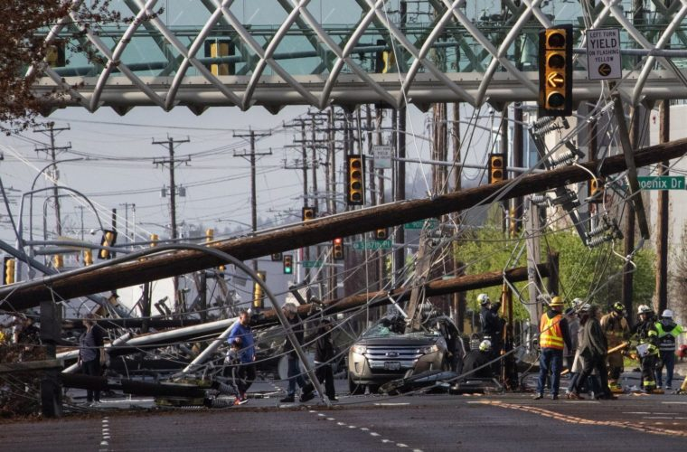 26 electricity poles in a row collapse on a street in Seattle for no apparent reason