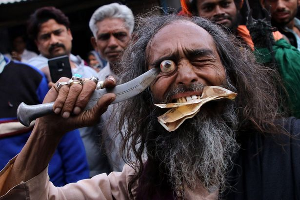 Worshipers use knives to expose their eyes at religious festival 31