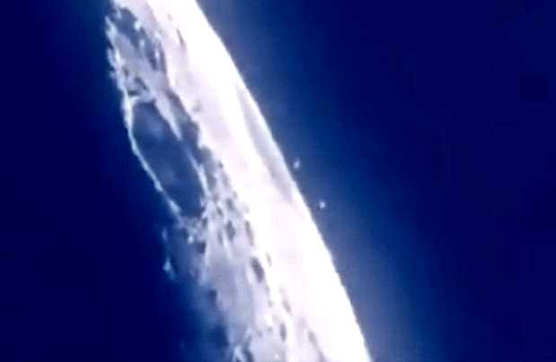 Amateur movie shows a UFO fleet heading for the moon 33