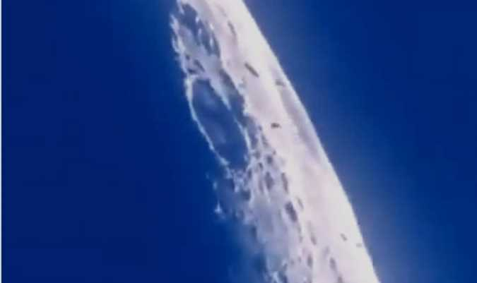Amateur movie shows a UFO fleet heading for the moon 35