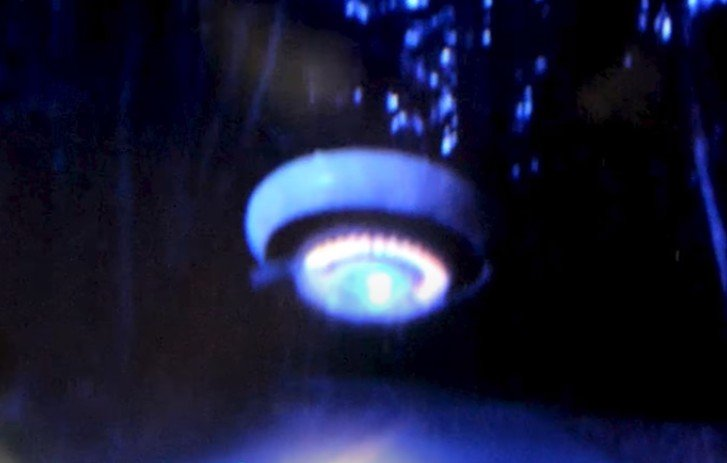 A woman photographs a UFO on an isolated Northern California road 39