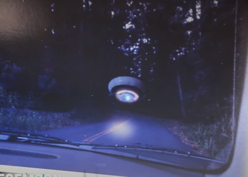 A woman photographs a UFO on an isolated Northern California road 38