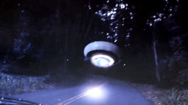 A woman photographs a UFO on an isolated Northern California road 30