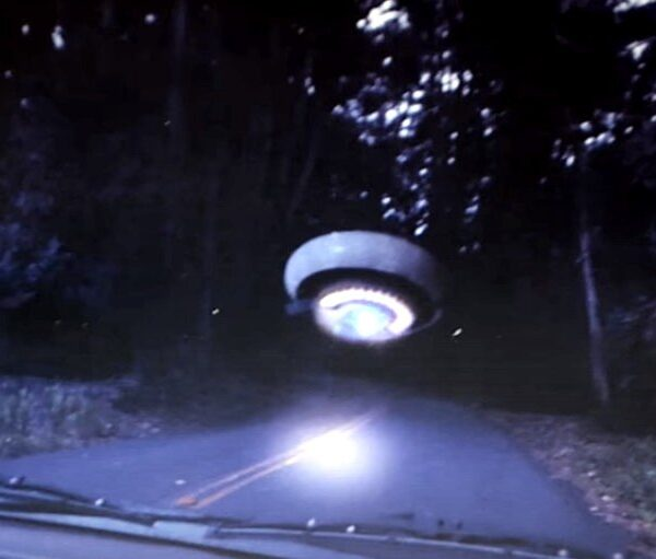 A woman photographs a UFO on an isolated Northern California road 33