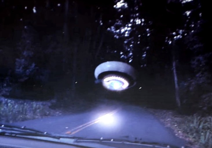 A woman photographs a UFO on an isolated Northern California road 37